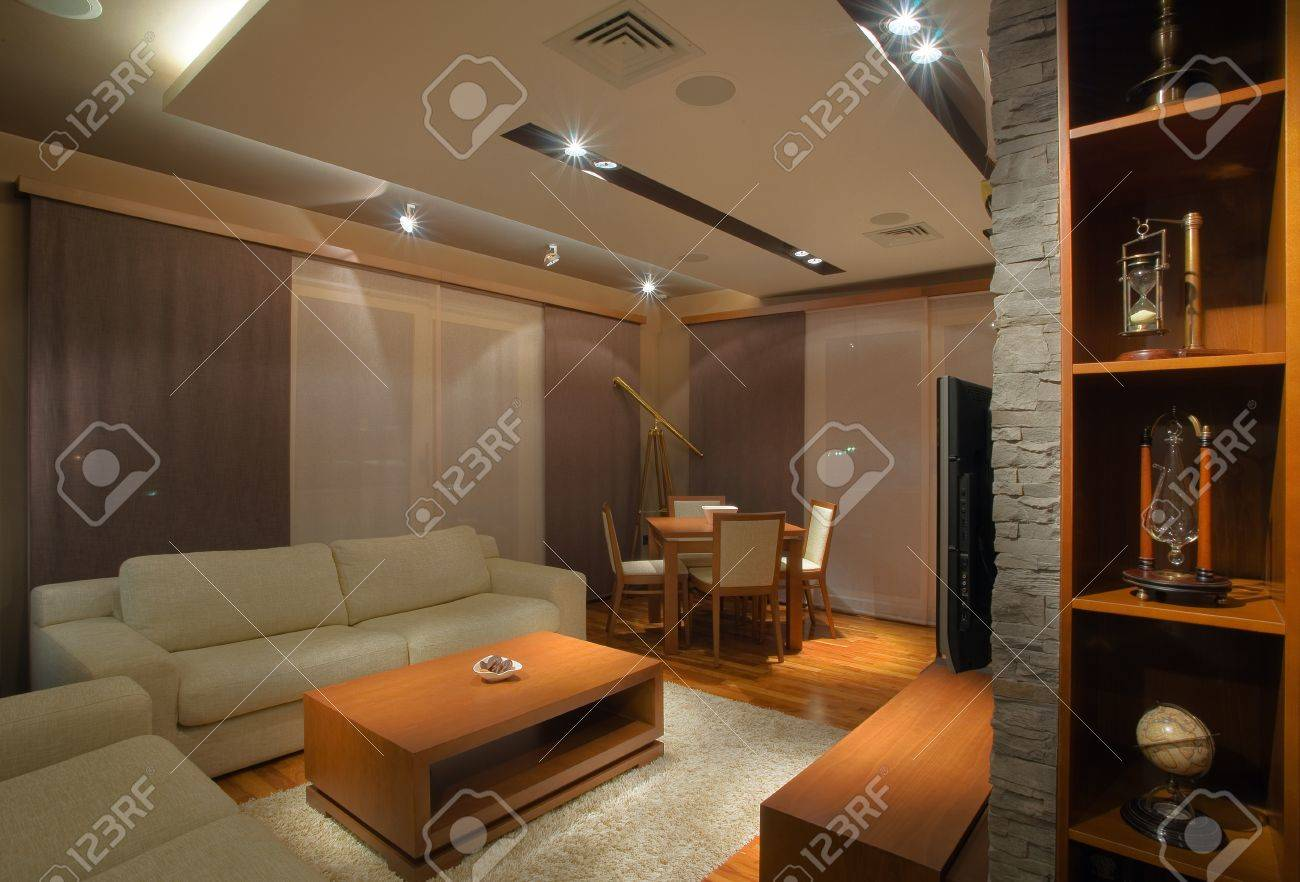 Modern interior of an apartment with handmade furniture and lighting equipment stock photo 8624774