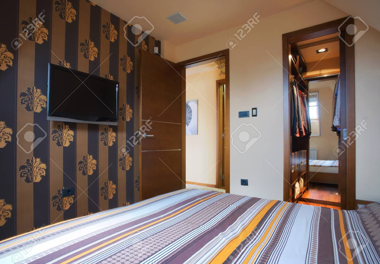 Interior of a bedroom, with modern furniture and light equipment. Stock Photo - 8624780