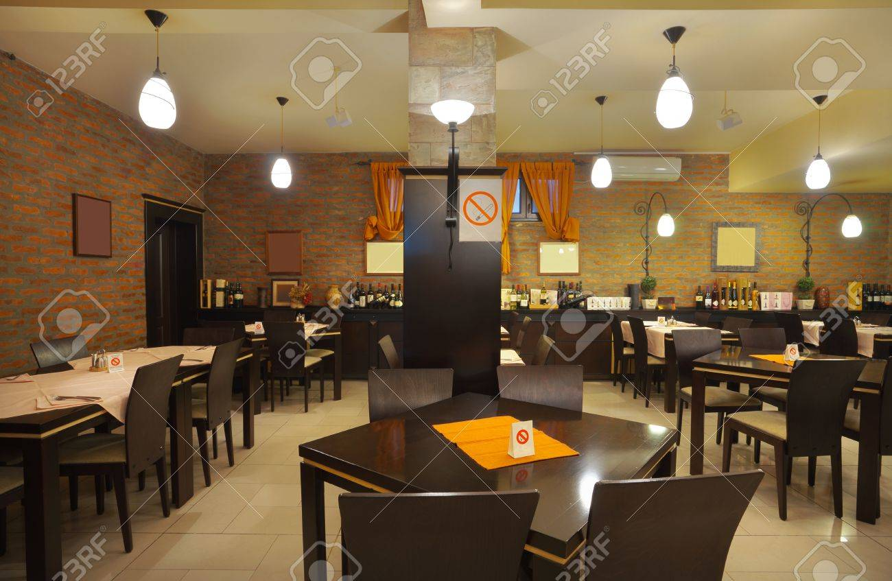 tables, chairs and brick wall, interior of a restaurant. stock
