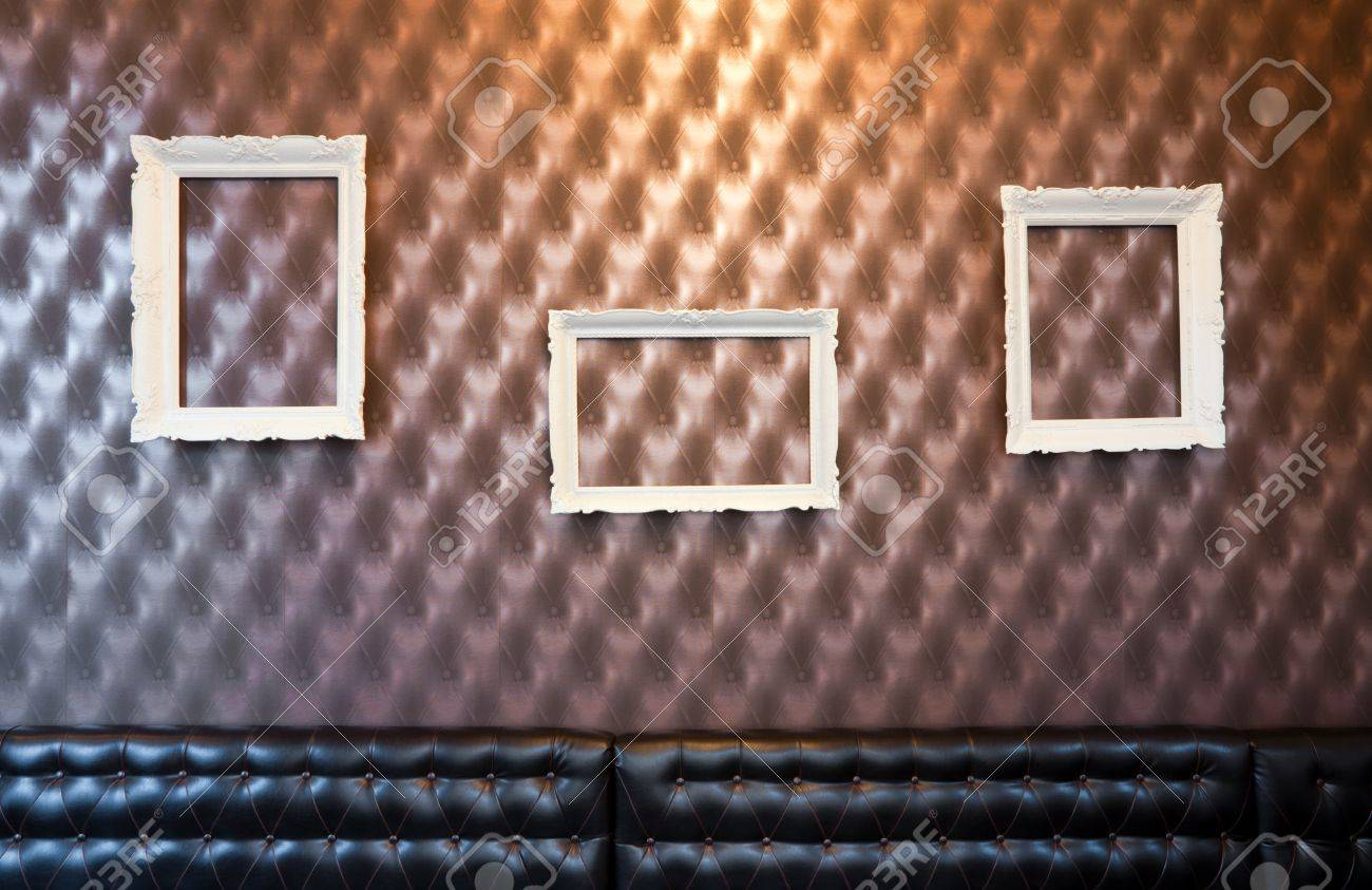 Three empty picture frames on the wall with wallpaper. Stock Photo - 9009652