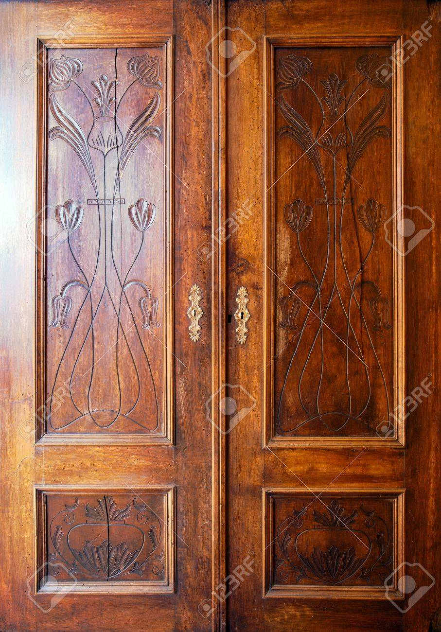 Details of an old closet doors with ornaments. Stock Photo - 9168969