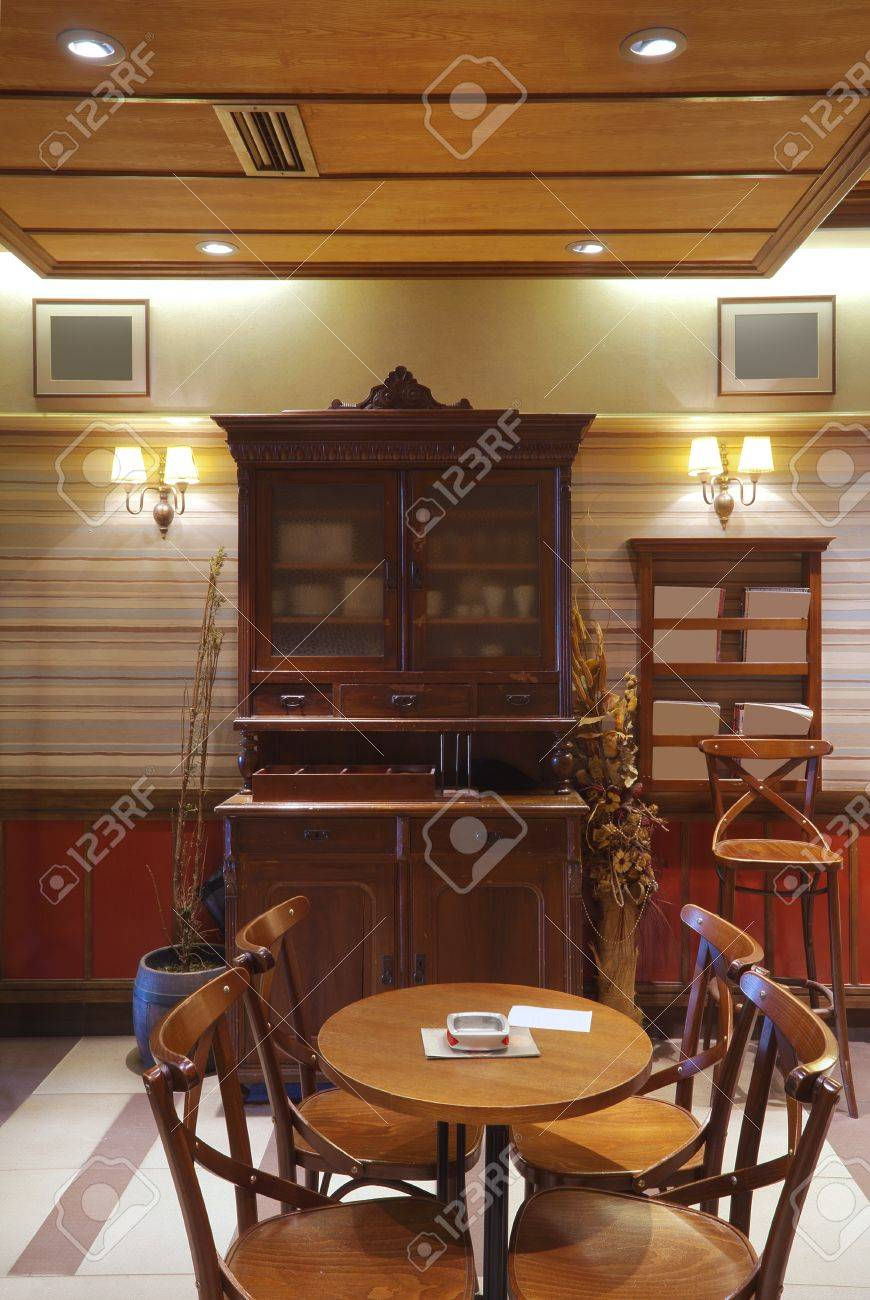 One part of a cafe, vintage style with wooden tables, chairs and old retro closet. Stock Photo - 9271049