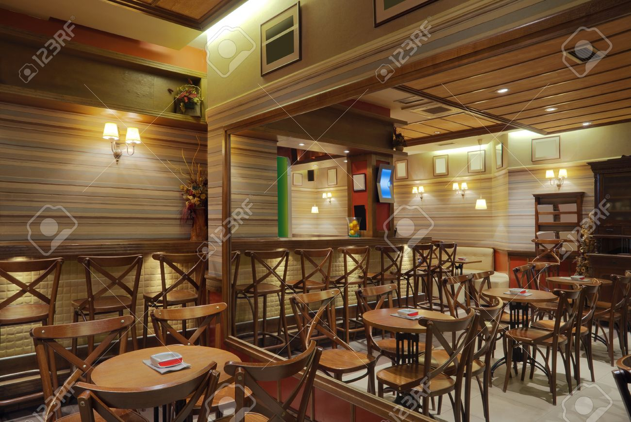 cafe interior with wooden furniture, lighting equipment