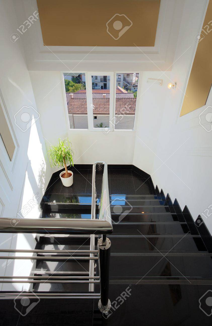 interior of a hotel, modern and simple stairs with metal fence