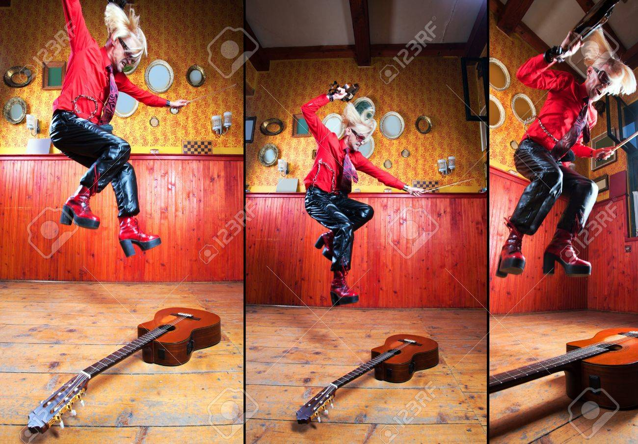 Funny musician with guitar and violin showing his expressions. Stock Photo - 10896849