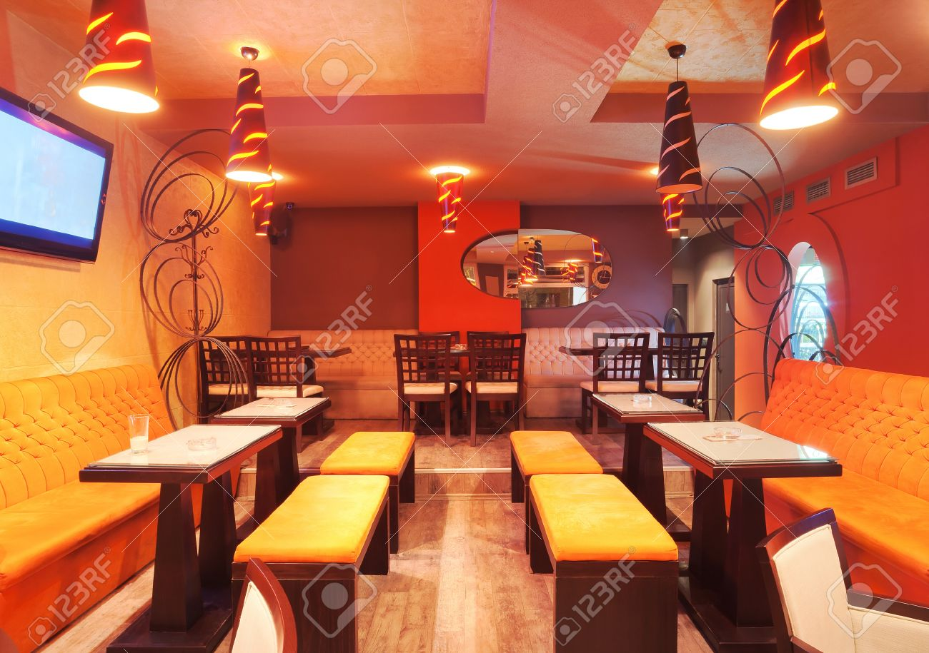 interior of a restaurant, modern design in few colors, orange