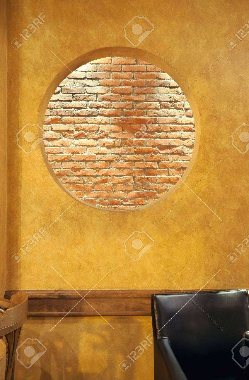 interior of a cafe, details of wall design, big round hole in