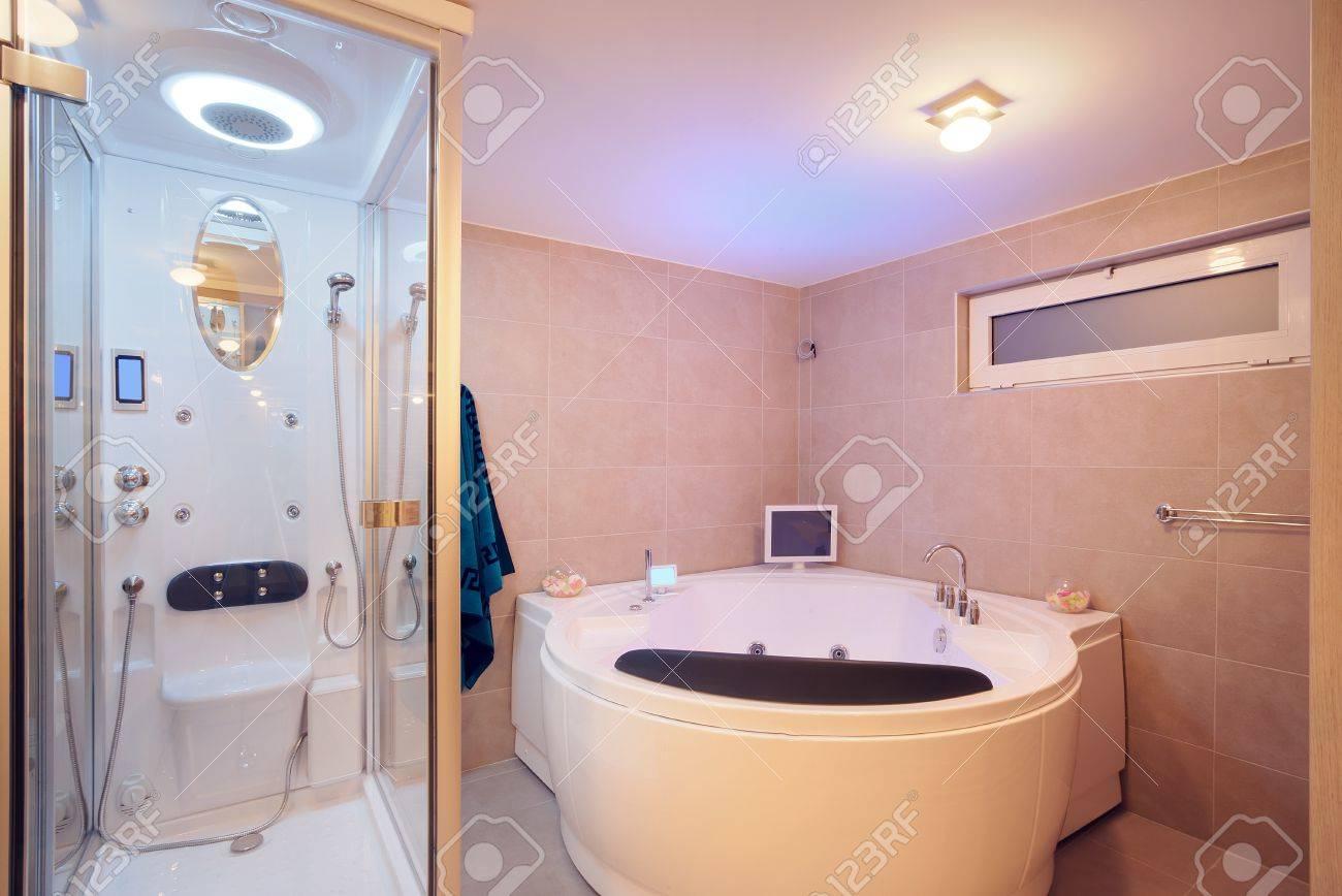 Interior of a modern bathroom details of jacuzzi and bathtub
