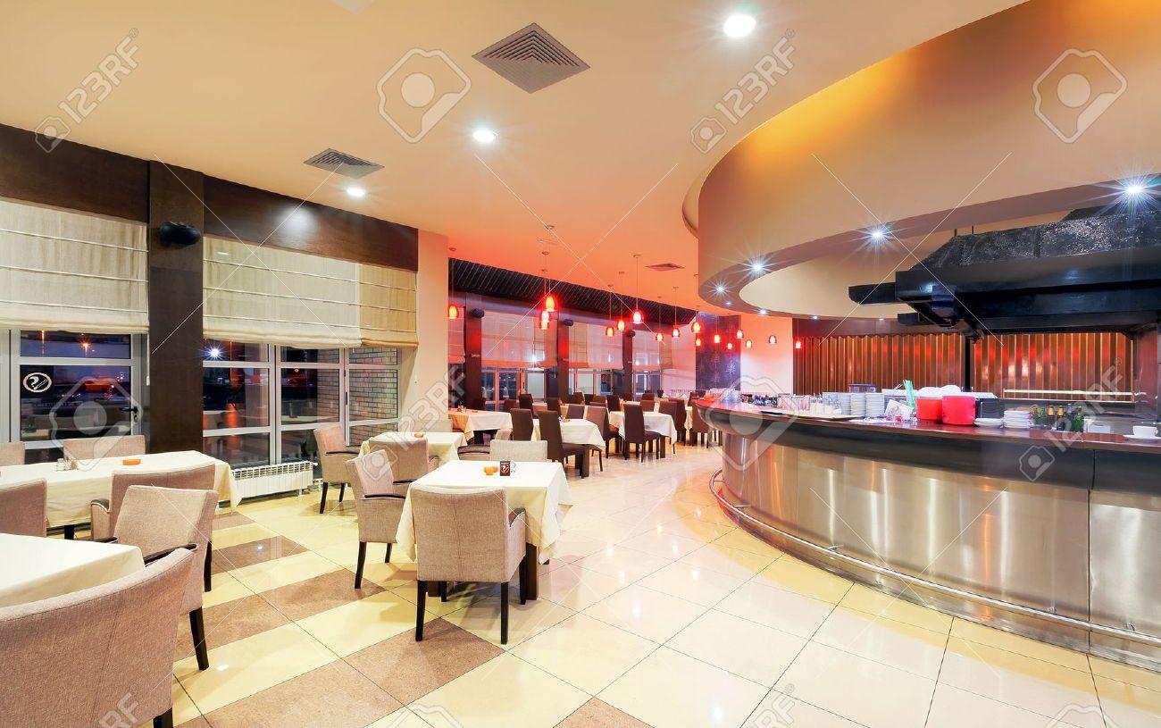 modern restaurant interior, part of a hotel, night scene. stock