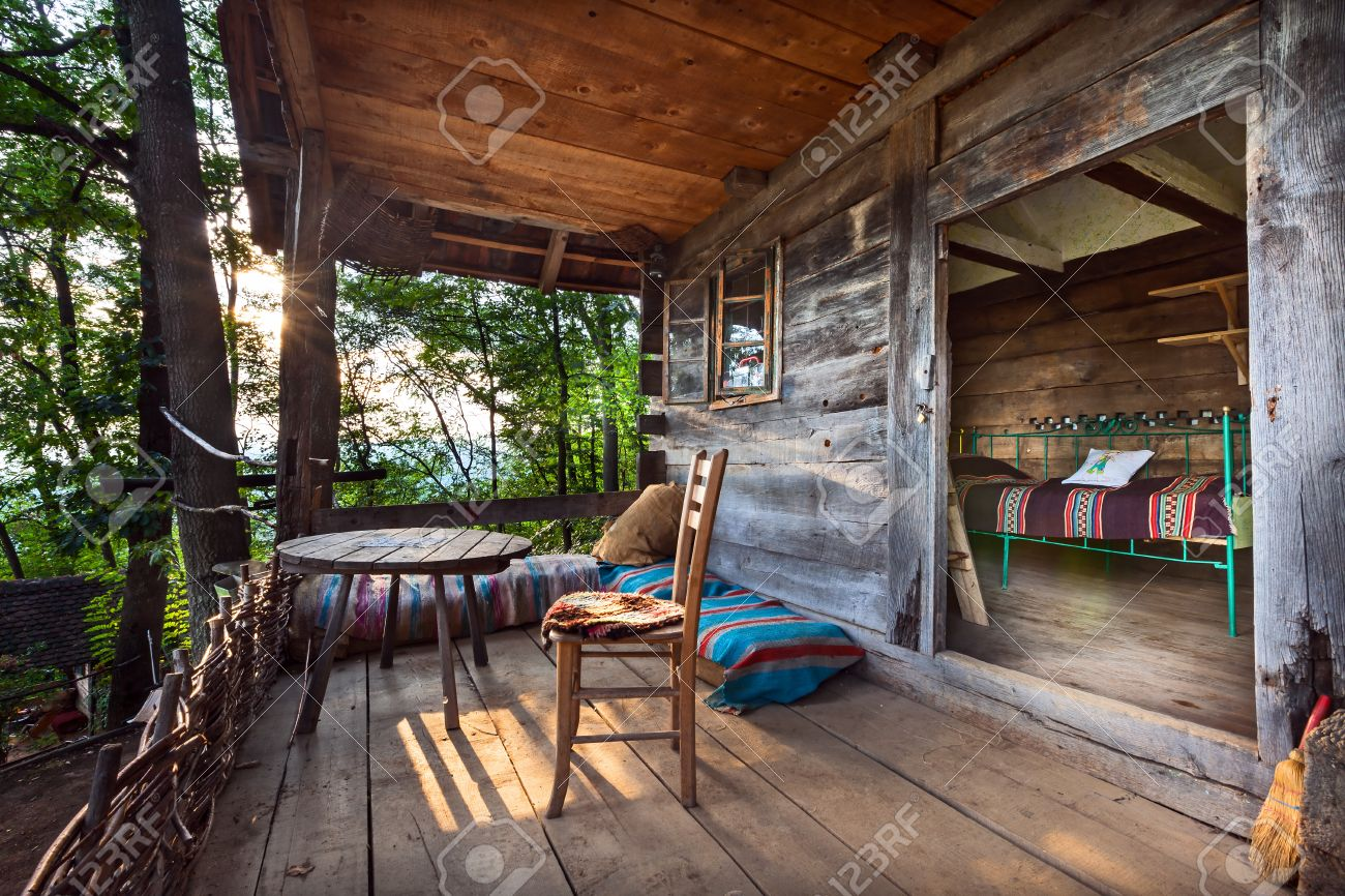 Wooden house in forest, house made of natural materials. Stock Photo - 22020430
