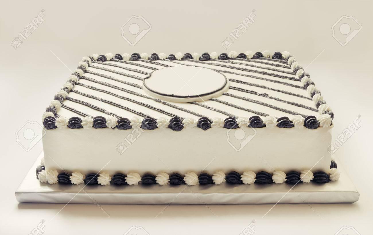 Birthday Cake Decorated With Black And White Cream Stock Photo