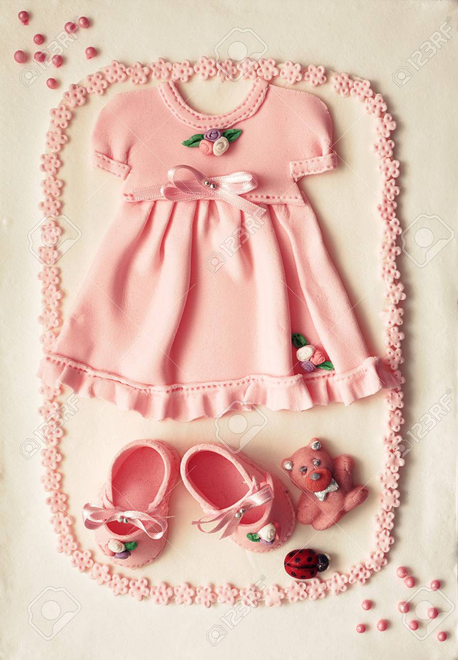 56b32a00eab2 Areal view on decoration of a birthday cake for baby girl ornaments made of  sugar in