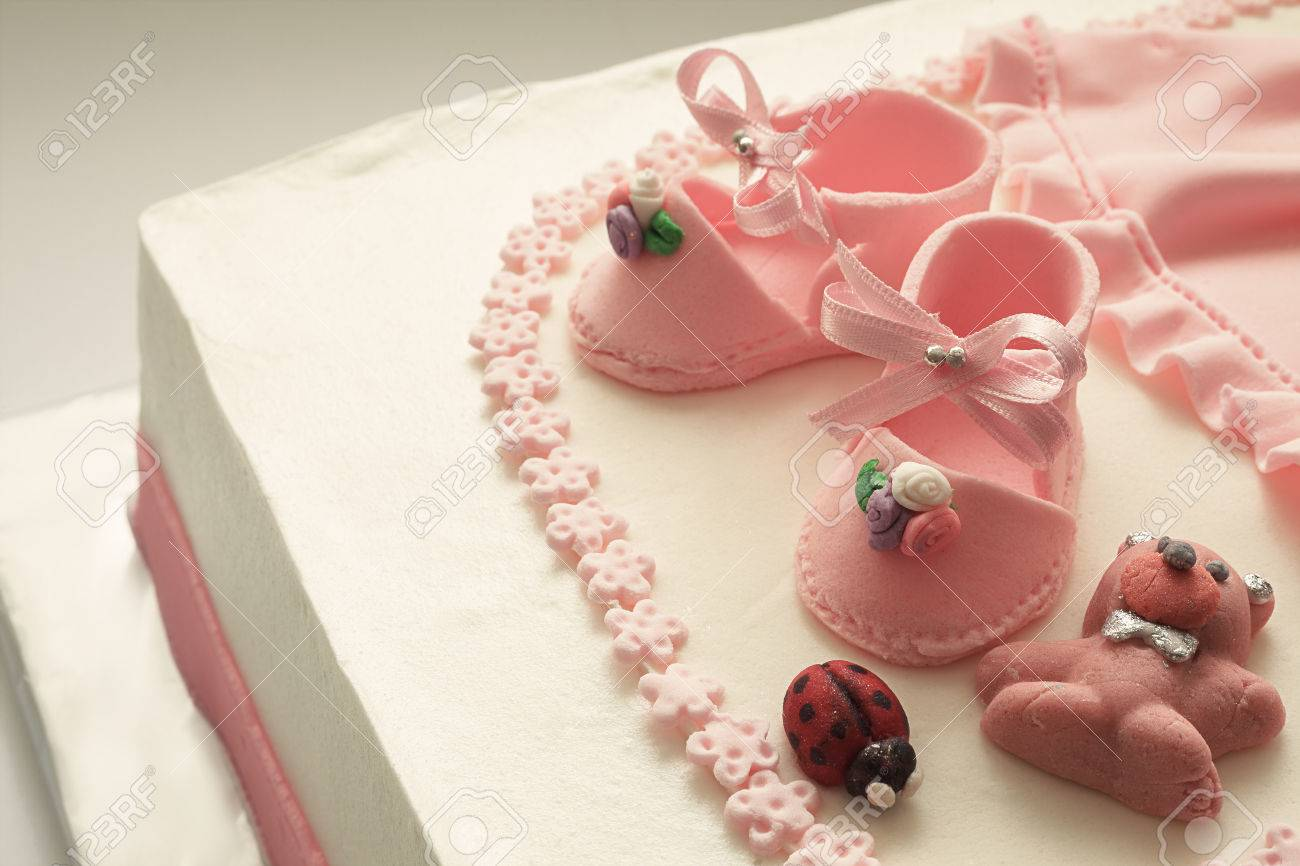 c328a26ba9ee Details of a decoration of birthday cake for little baby girl. Shoes and dress  made