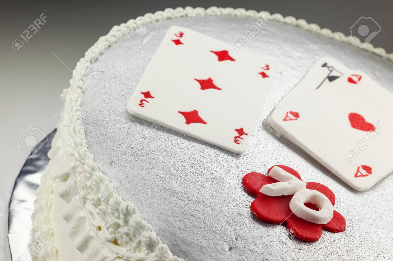 Design And Decoration Of A 70 Birthday Cake With Gambling Cards On Top Stock