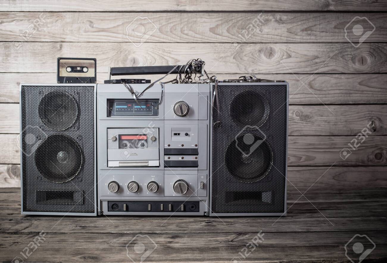 old tape recorder and cassette on wooden background - 148528860
