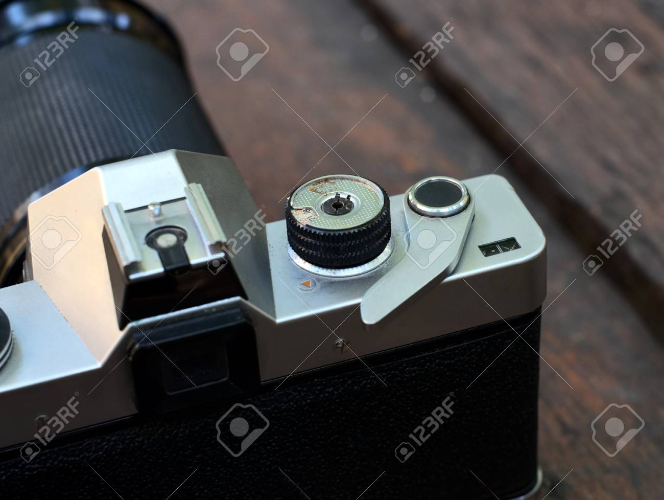 old film SLR camera with lens Stock Photo - 17958563