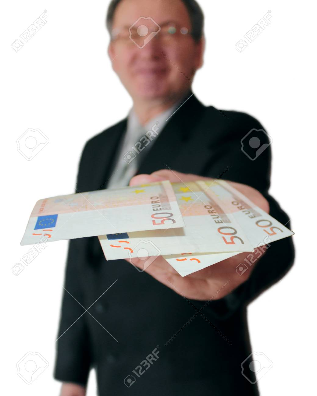 Money in hand of the successful businessman isolated on white. Stock Photo - 11421941