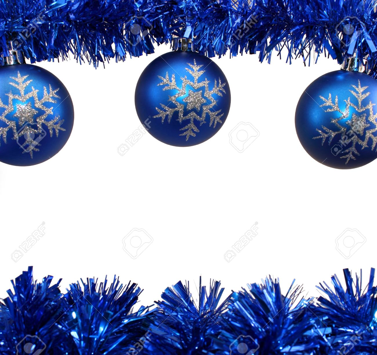 Snowflake Blue Christmas Decorations and Blue Tinsel on White Background.  Stock Photo - 11727460
