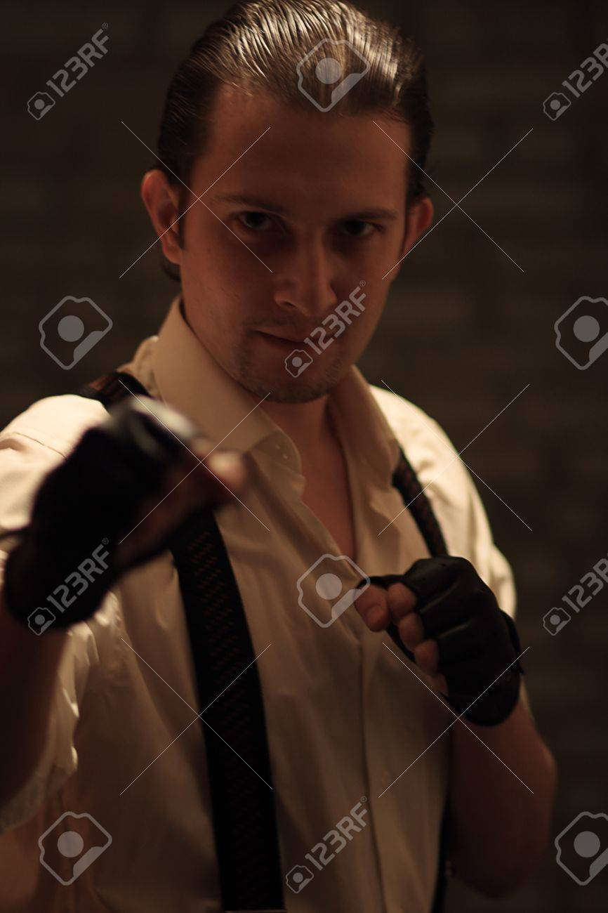 Portrait of young serious mafia man Stock Photo - 17928374