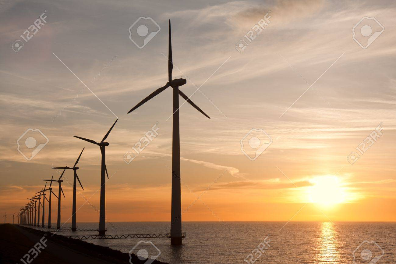 Row of windturbines in the sea and a beautiful sunset - 9335392