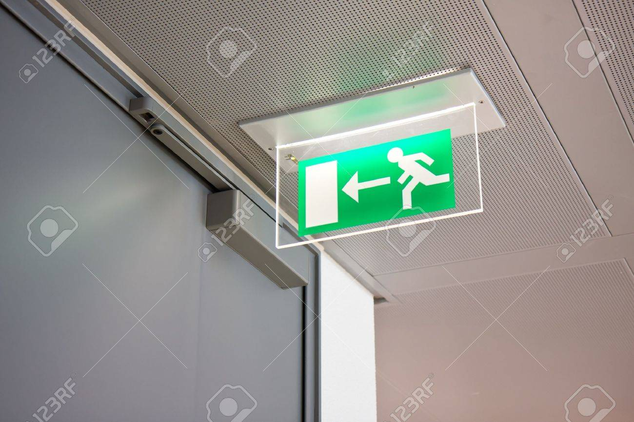 emergency exit sign in a building - 9956501