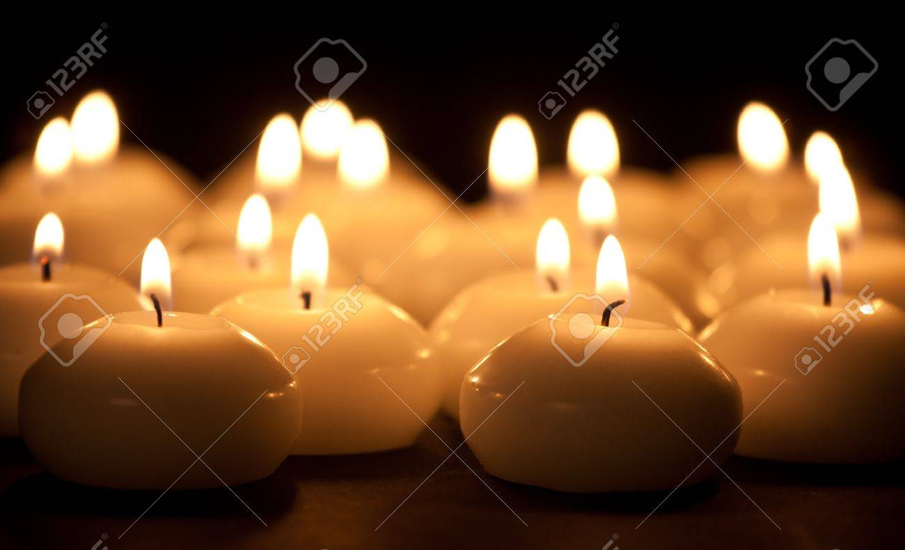 Group of burning candles at a black background with selective focus - 11156600