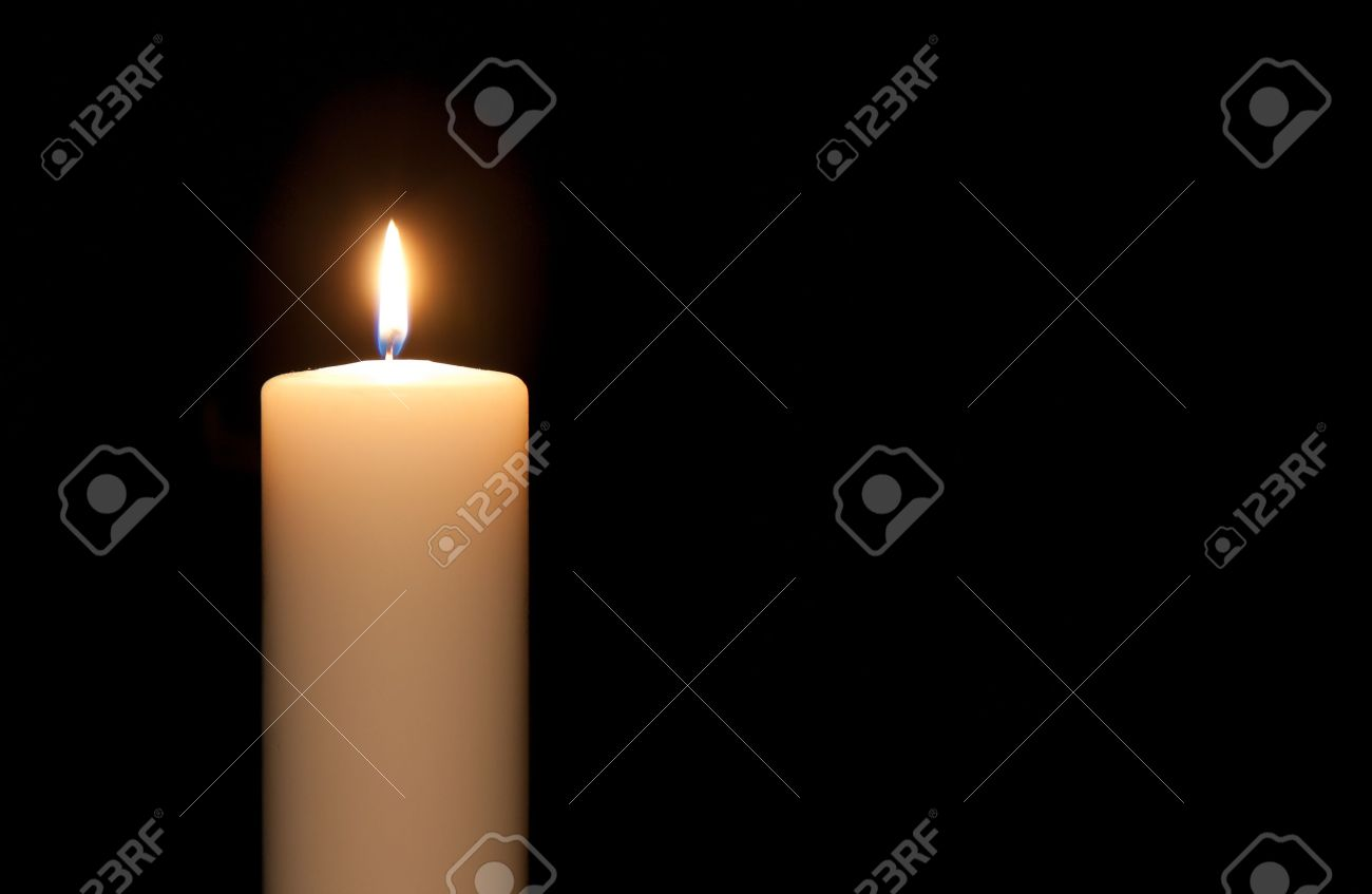 White candle isolated against a black background - 11713617