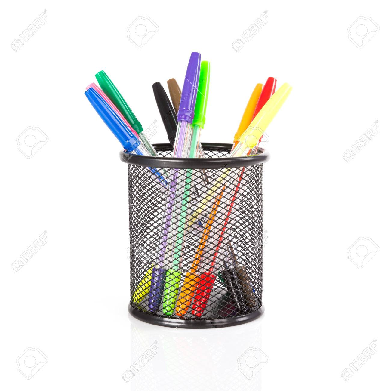 Colorful pencils in a black basket over a white background - 25275800