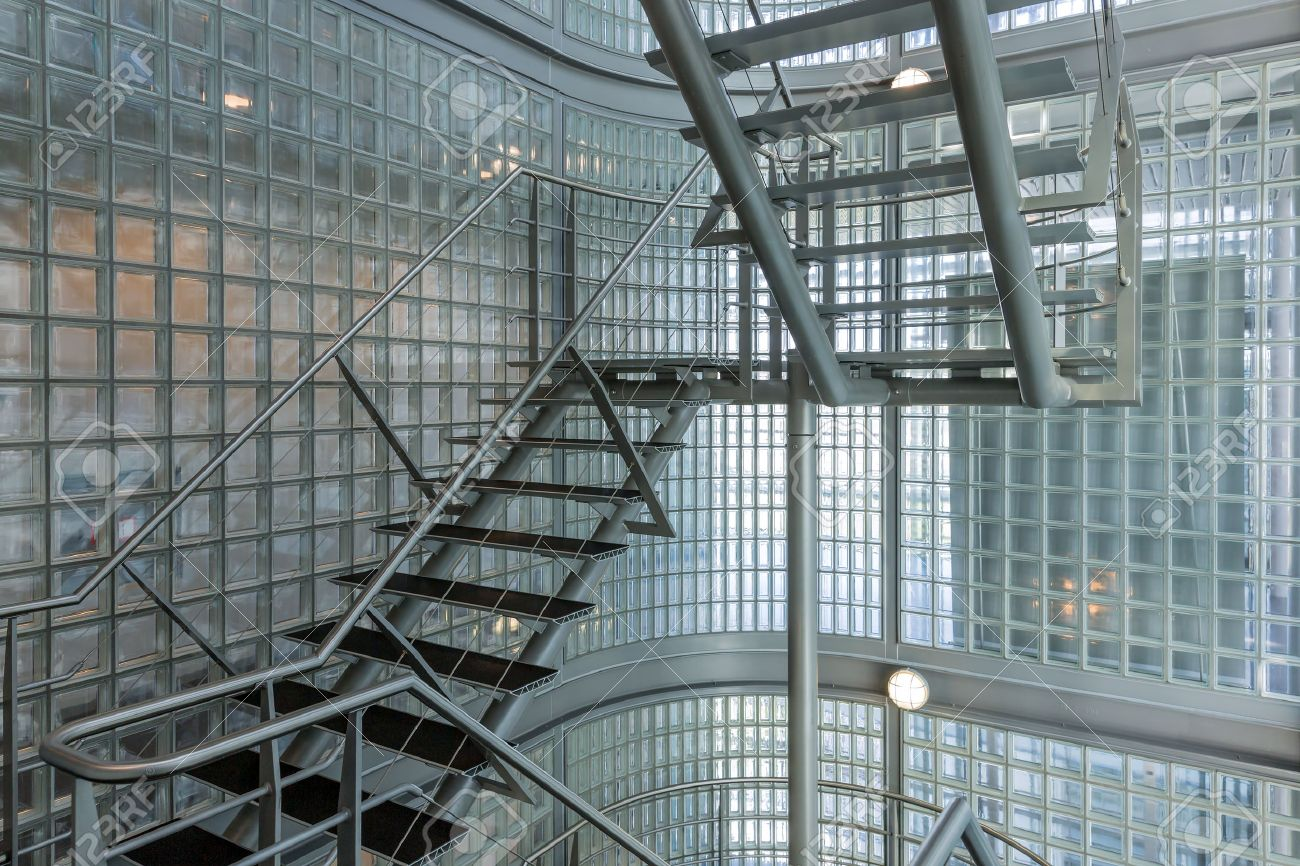 Steel stairway in a modern office building - 27702552