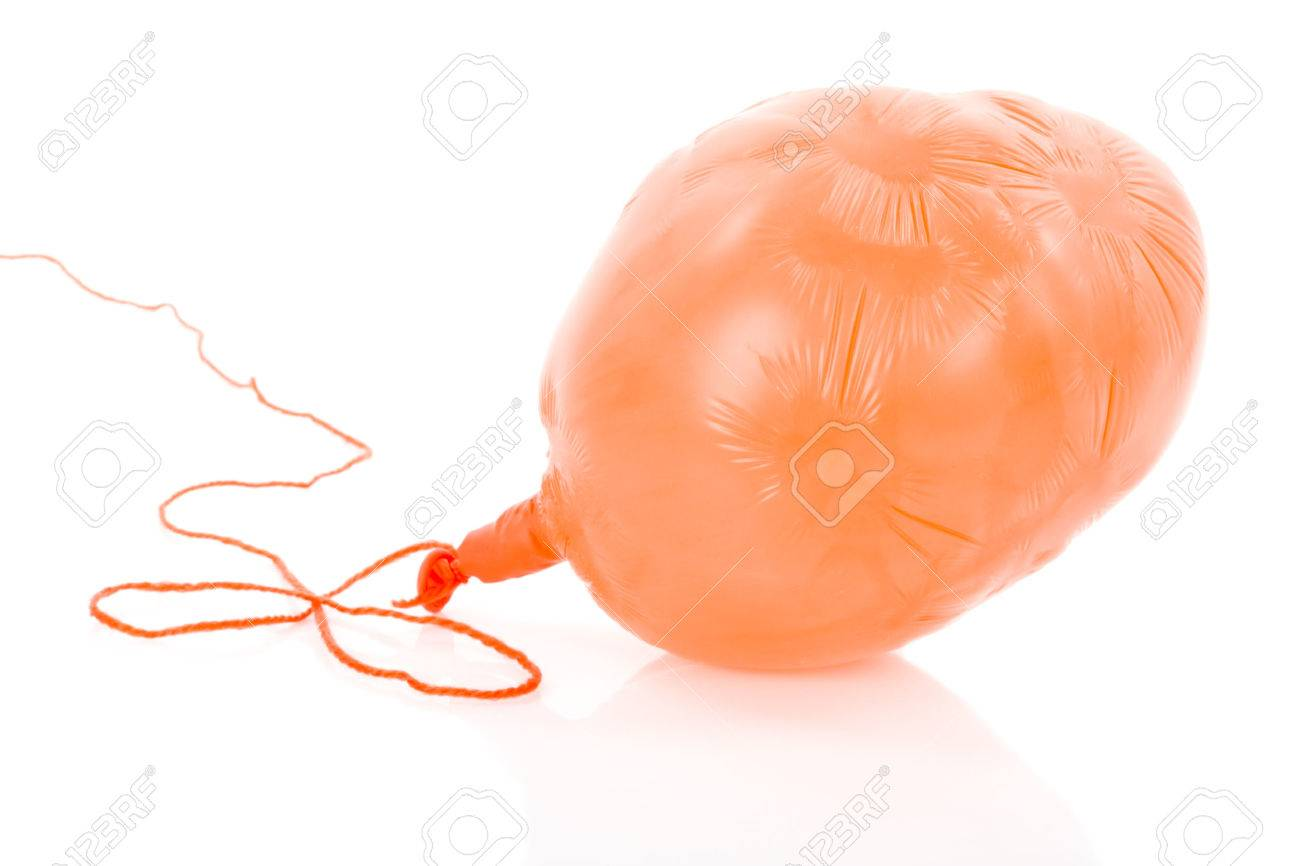 Deflated orange balloon at a rope; isolated over white background - 28447310