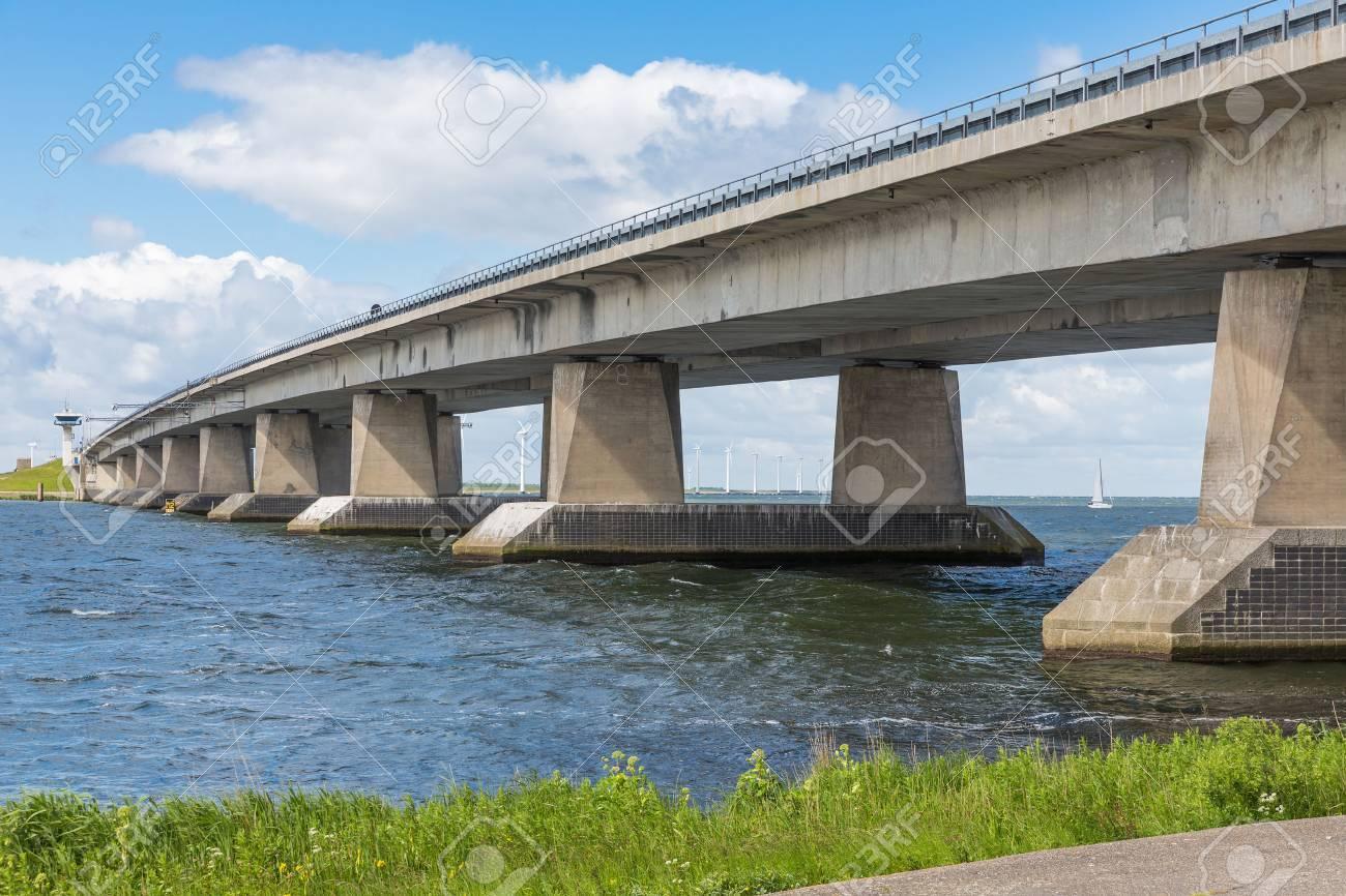 Big concrete bridge over Dutch lake near Lelystad - 40547555