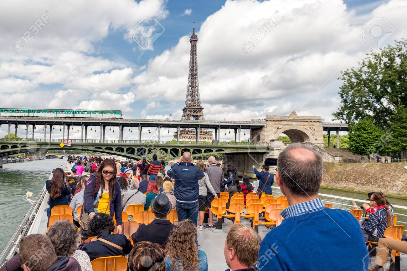 paris france may 28 tourists at a seine river cruise admiring