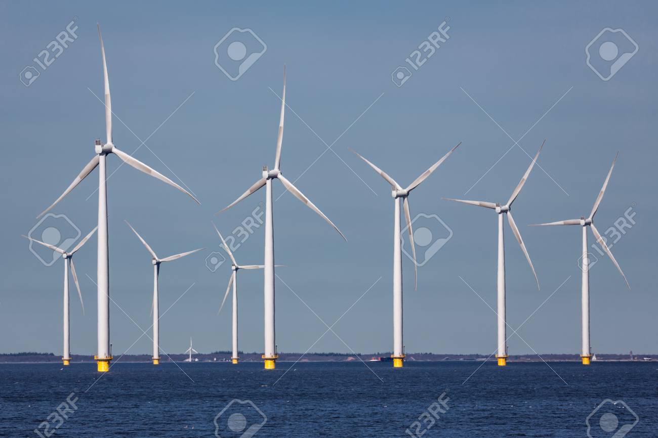 Offshore farm windturbines near Dutch coast against blue sky - 75805690
