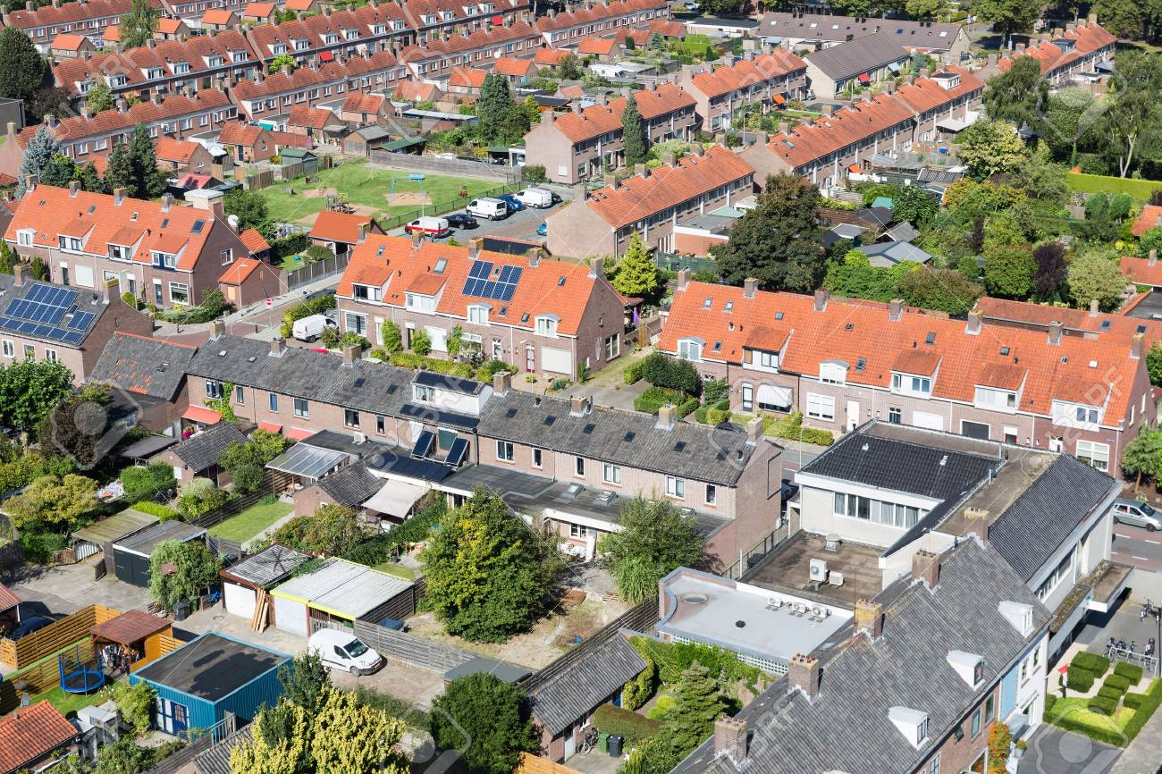 Aerial view family houses with backyards in residential area of Dutch village Emmeloord - 90440196