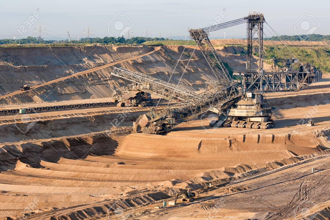 Brown Coal Open Pit Landscape With Enormous Digging Excavator Stock Photo Picture And Royalty Free Image Image 104576403