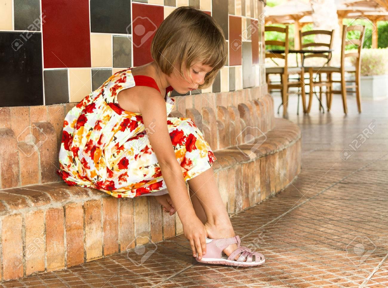 Little Girl Wears Pink Sandals. Stock