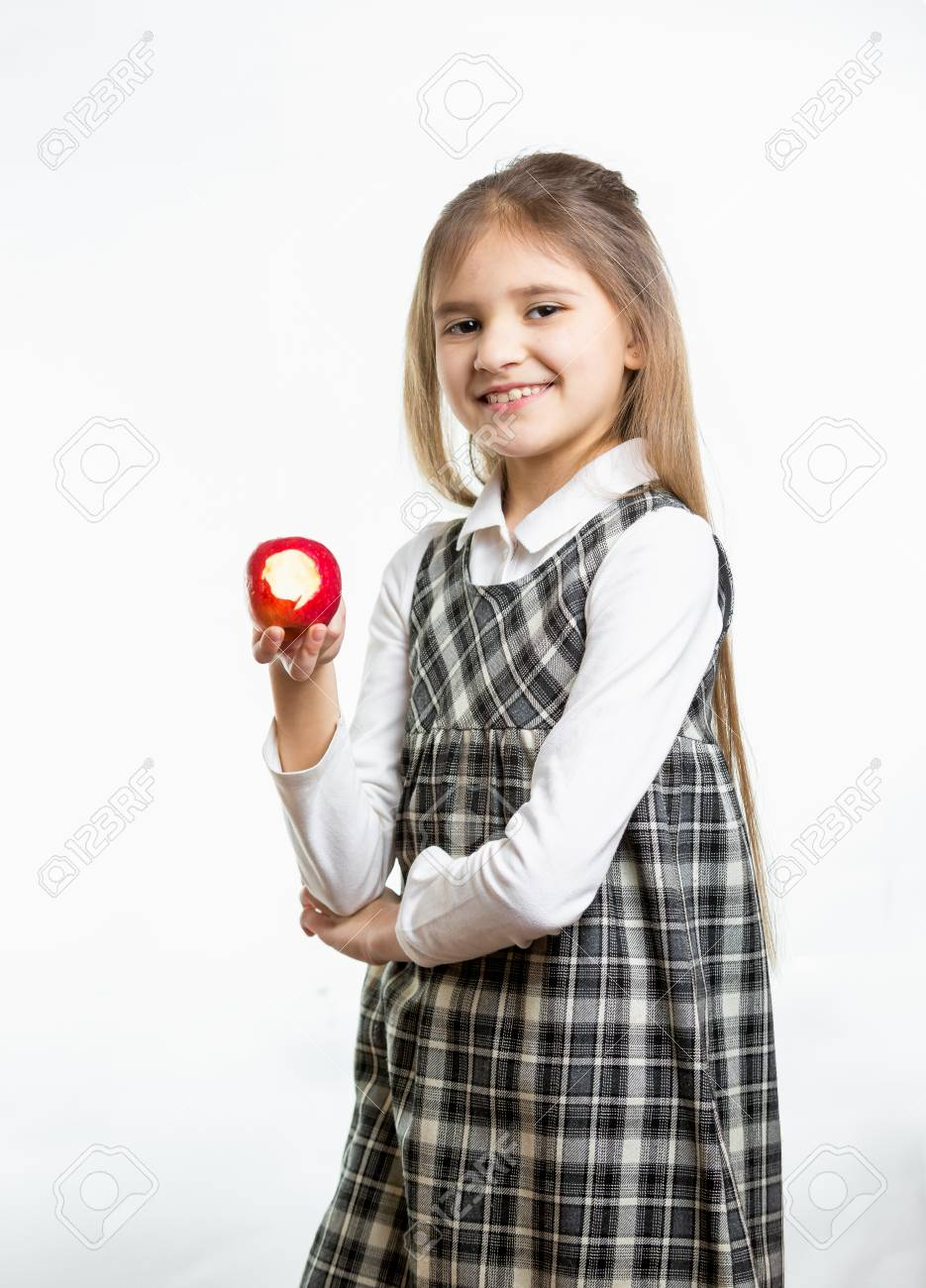 c71689d8edfc Isolated portrait of happy girl in school uniform holding red apple Stock  Photo - 41102189