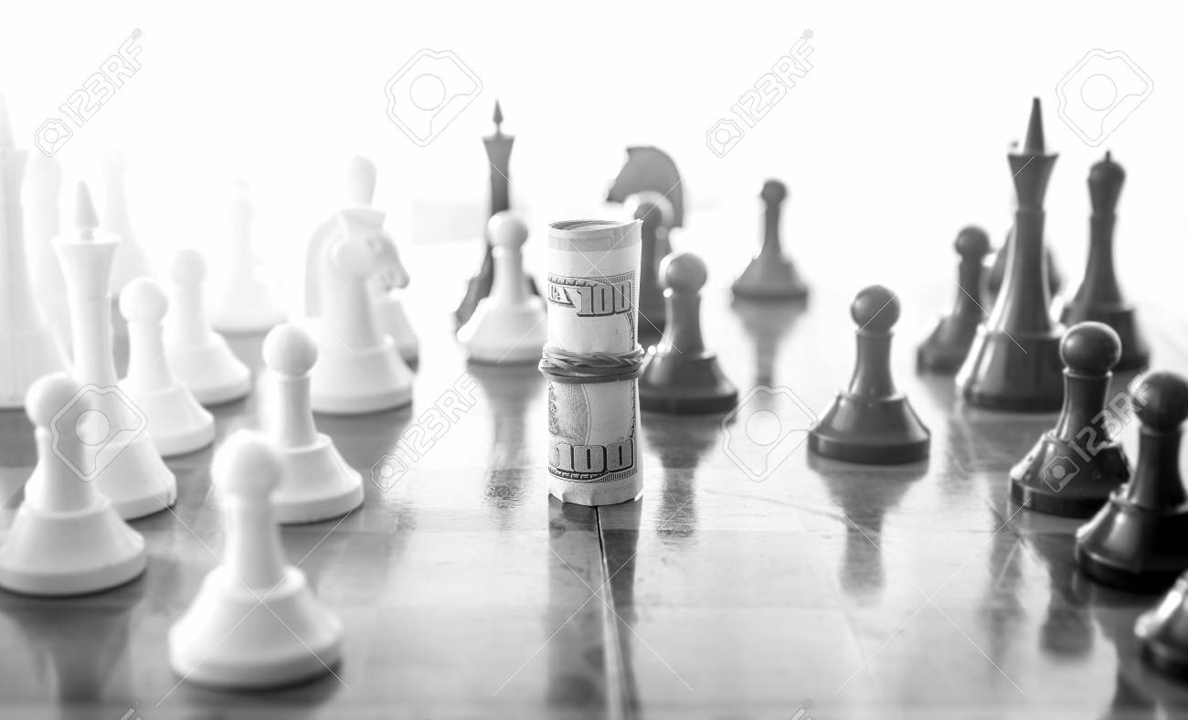 Black and white conceptual photo of wrapped money playing in chess as chess piece - 41475311