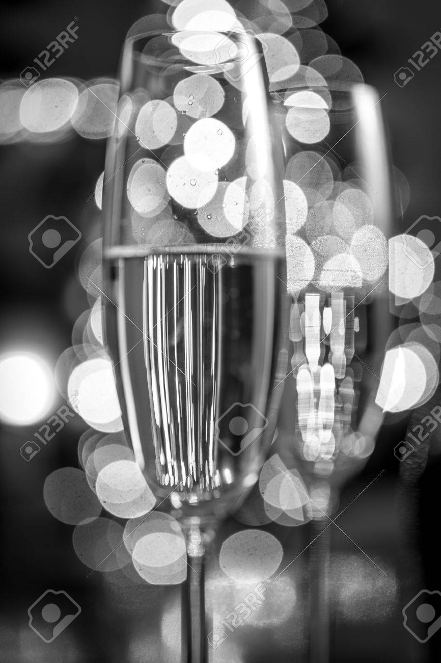 Macro Black And White Photo Of Two Champagne Glasses On Background Christmas Lights Stock