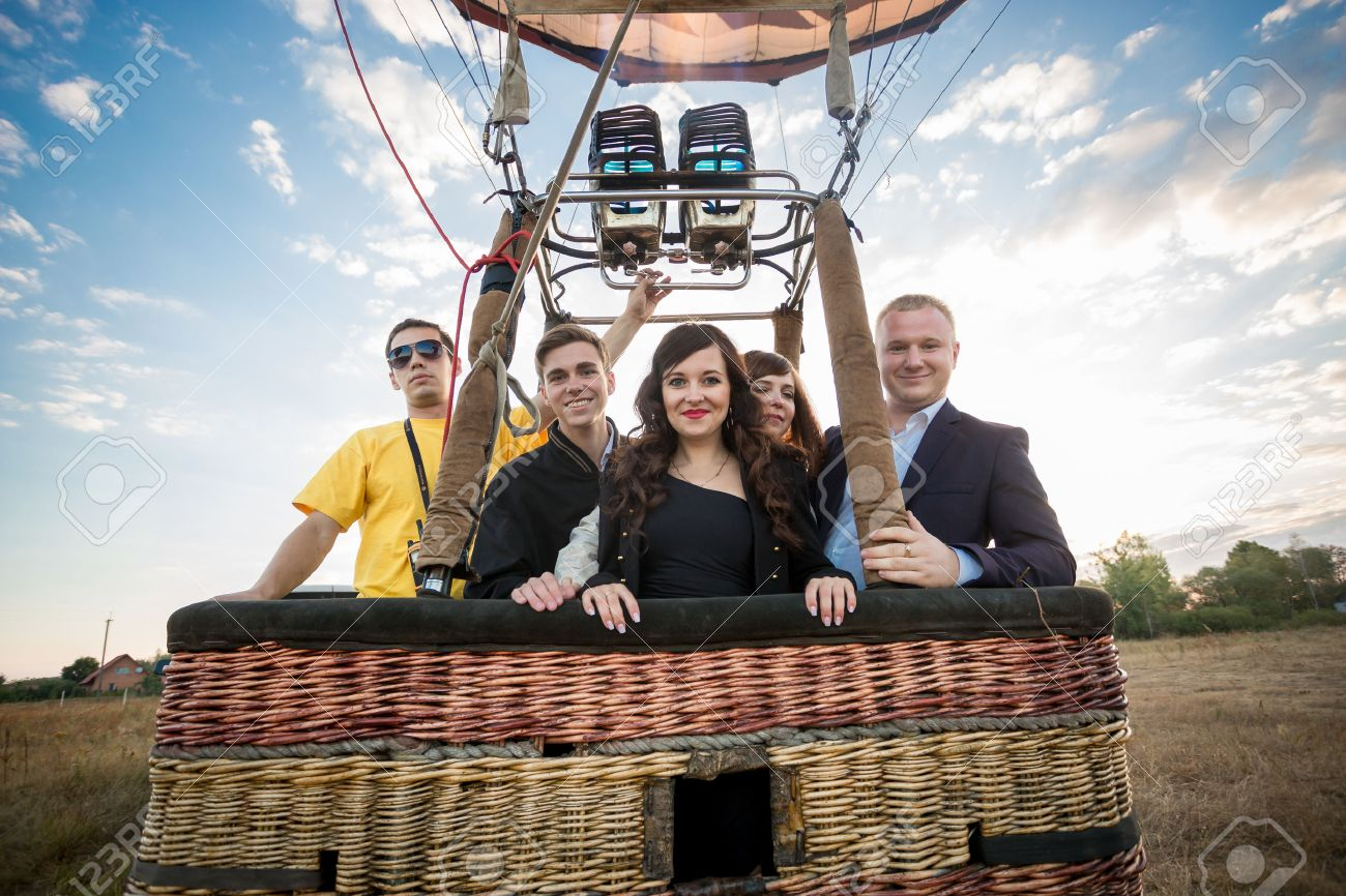 Happy group of people posing in hot air balloon basket - 51809442