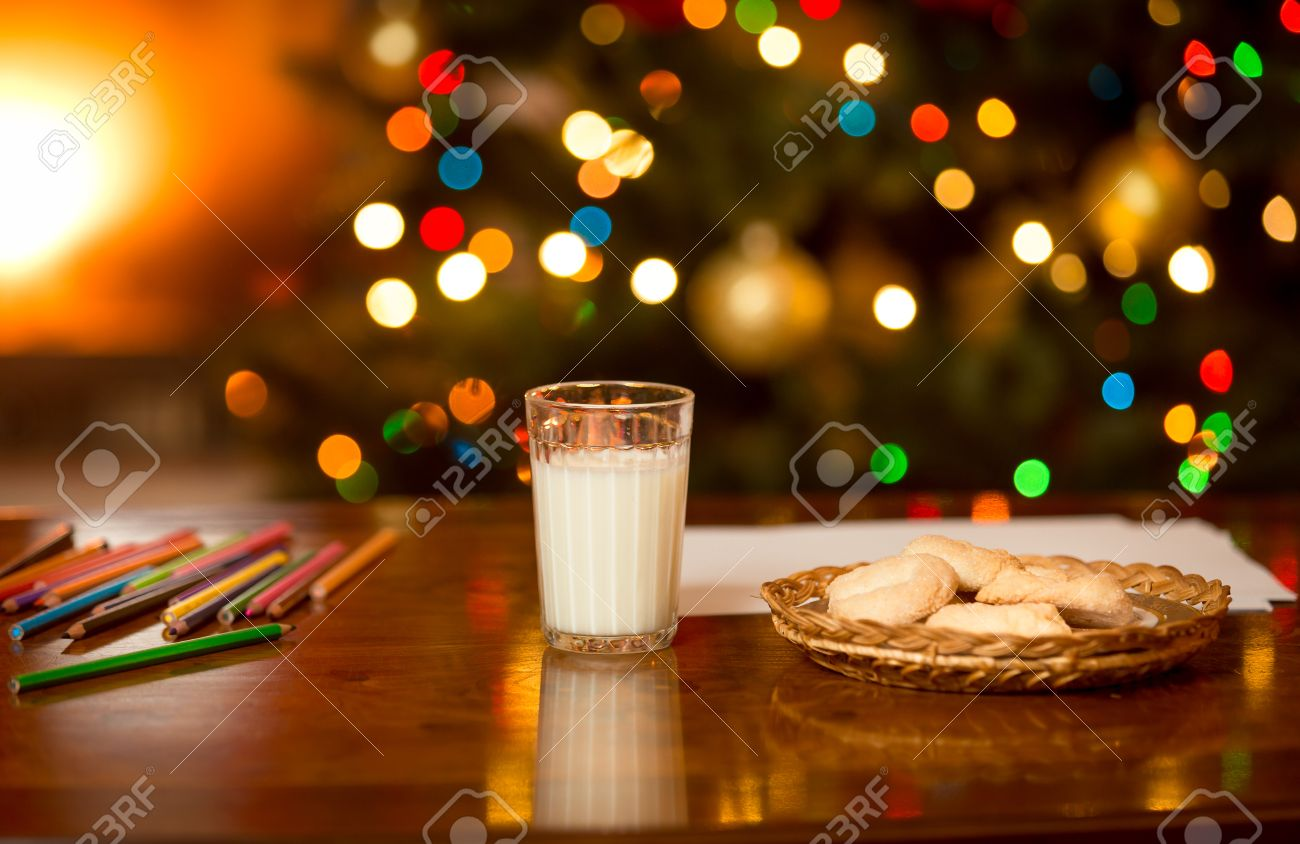 Glass Of Milk And Cookies Waiting For Santa Claus At Christmas