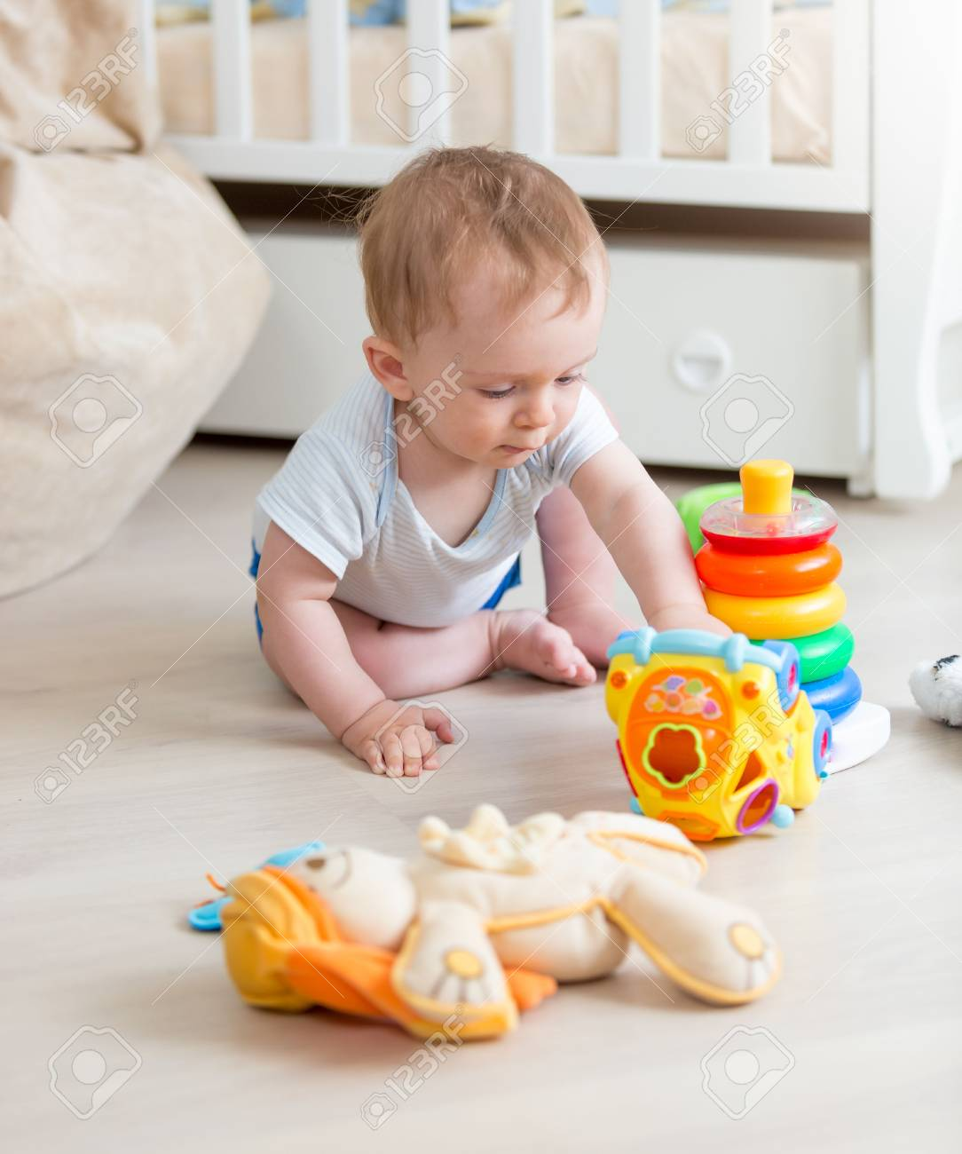 Cute 9 Months Old Baby Boy Playing With Colorful Toys On Floor - 9-month-old-baby-toys