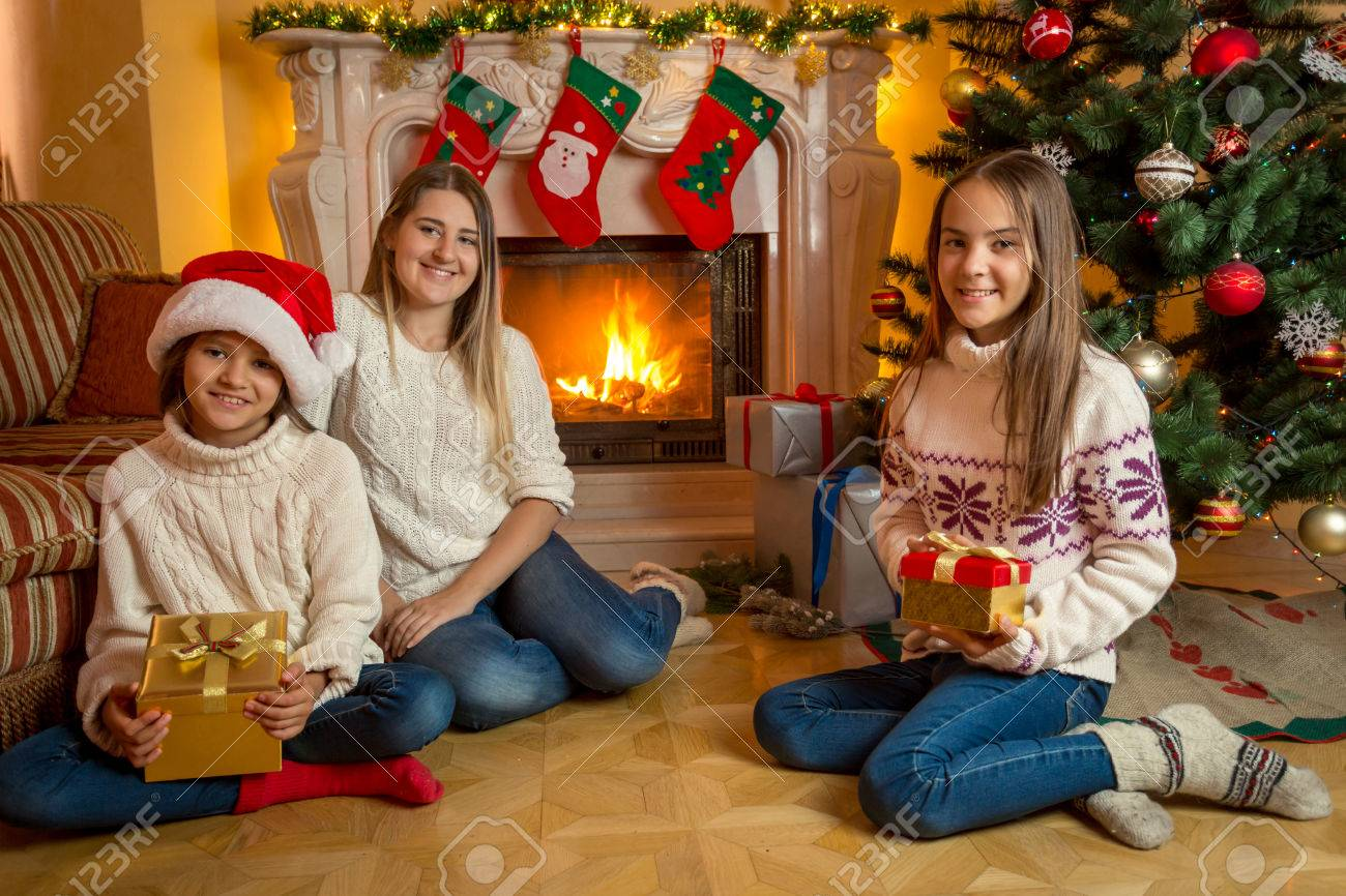 Happy Young Mother And Two Daughter Sitting With Christmas Gifts ...