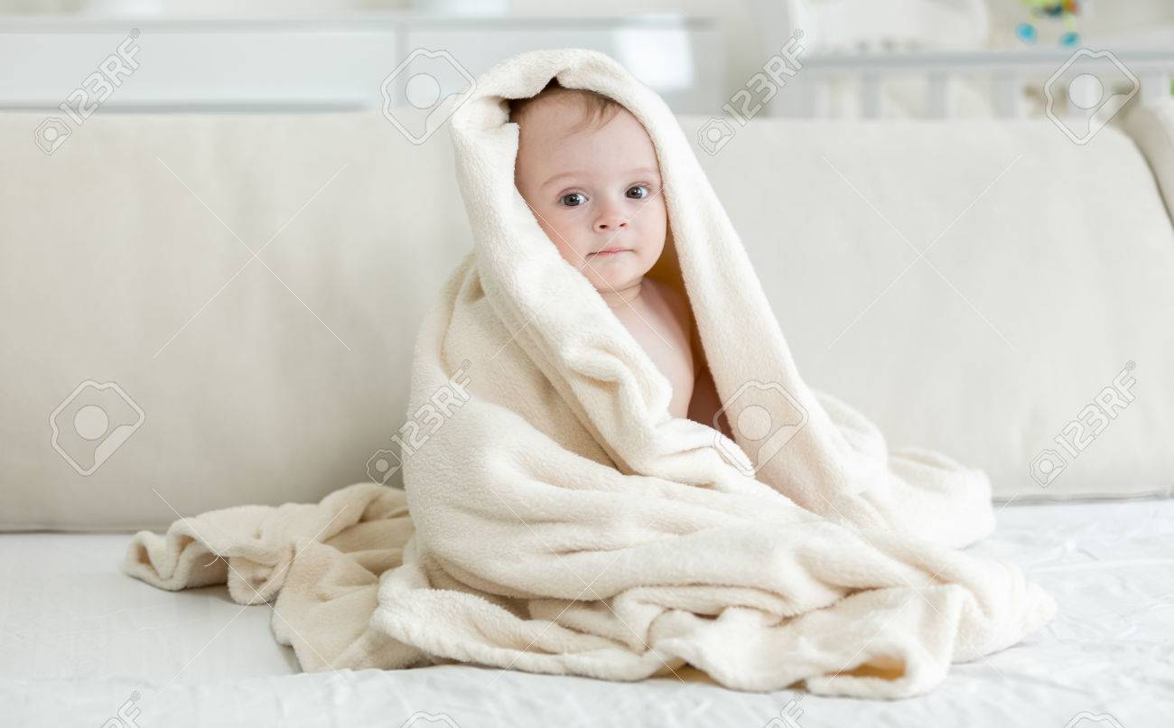 Baby Boy Covered In Big Towel After Bathing Stock Photo, Picture And ...