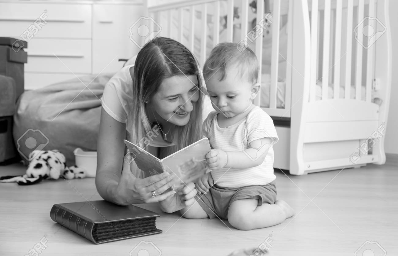 Black And White Image Of Beautiful Young Mother Reading Book Stock Photo Picture And Royalty Free Image Image 81051962