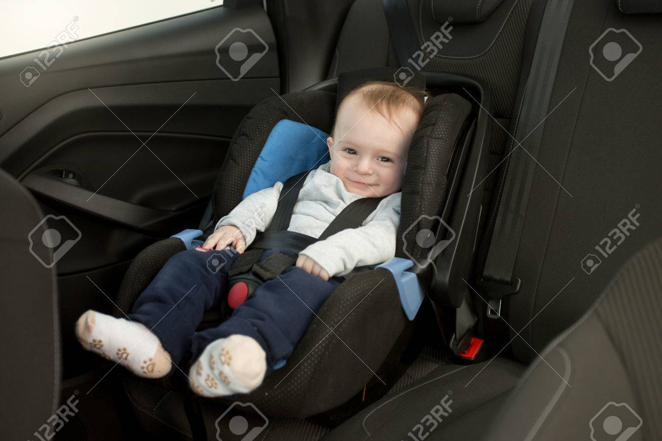 6 Months Old Baby In Car Child Seat Stock Photo