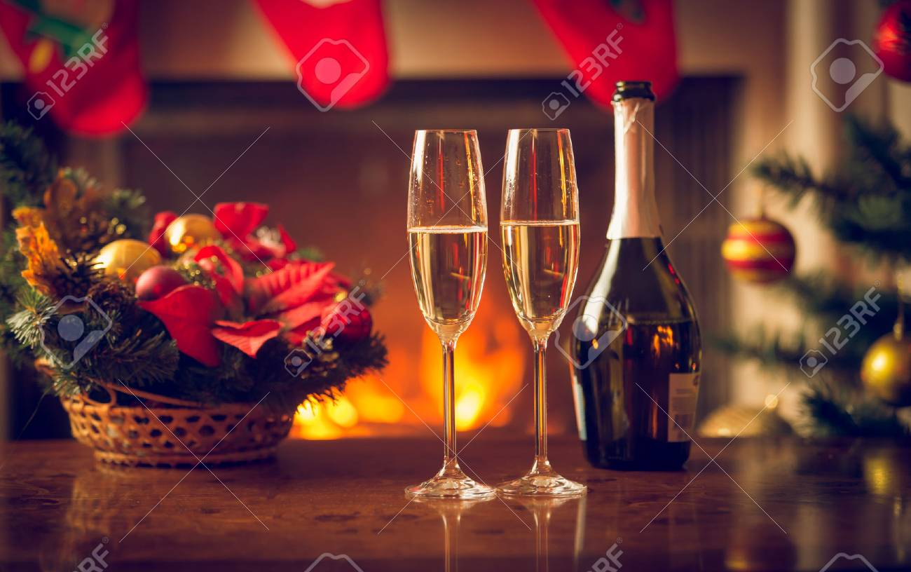 Closeup image of two glasses of champagne on Christmas table - 81100717
