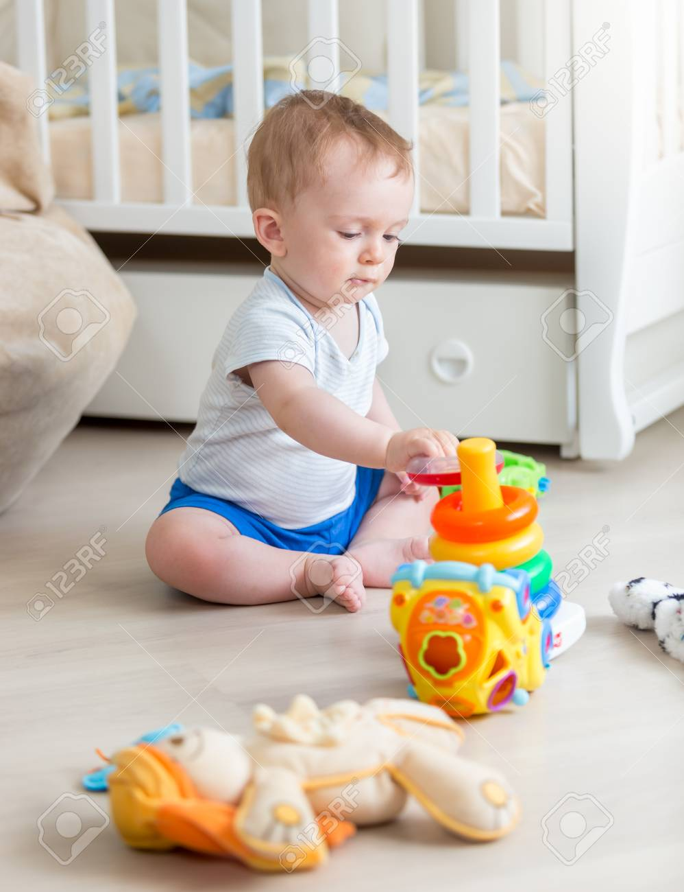 10 Months Old Boy With Educational Toys On Floor At Bedroom Stock P O 101085926