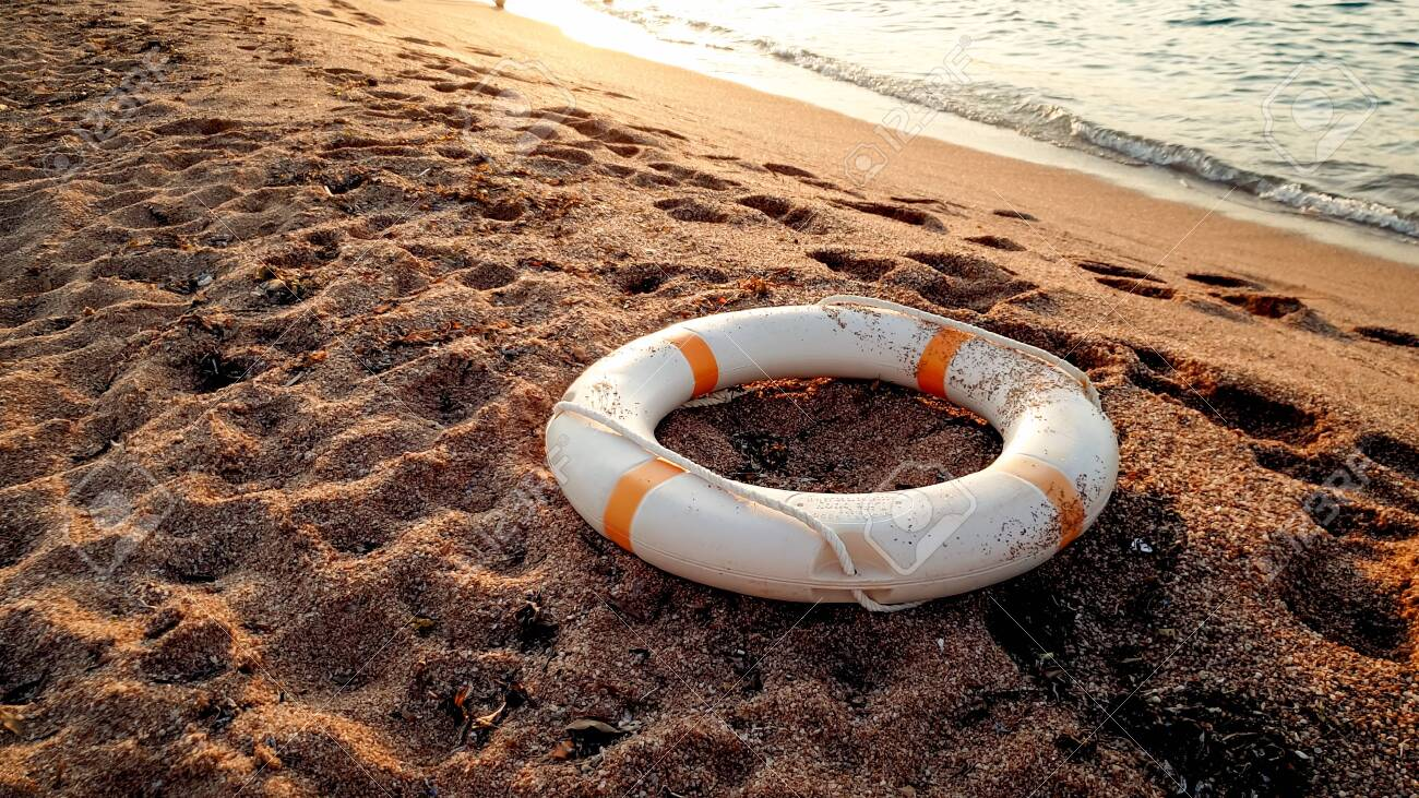 Closeup photo of white plastic life saving ring lying on the