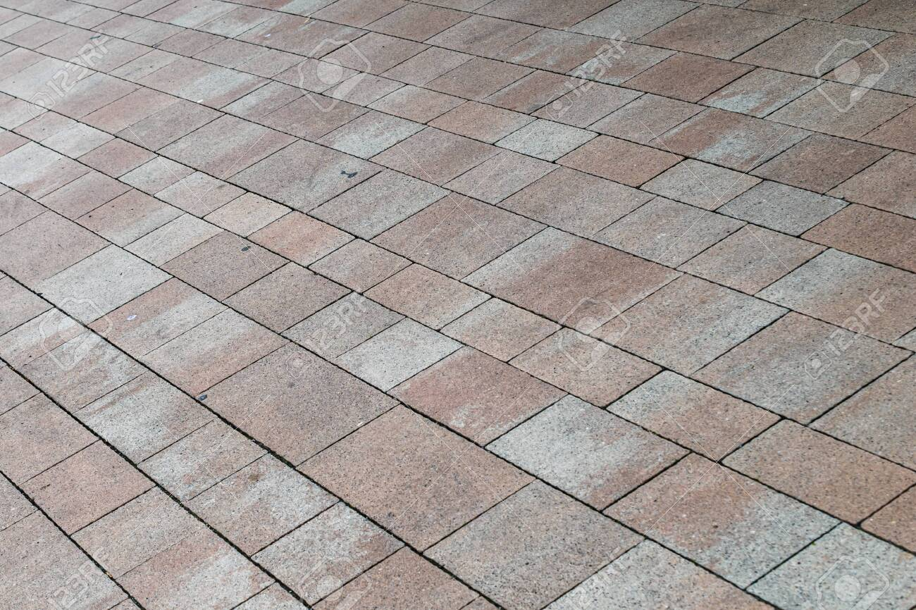 pavement of brown cobblestones. texture. - 146577458